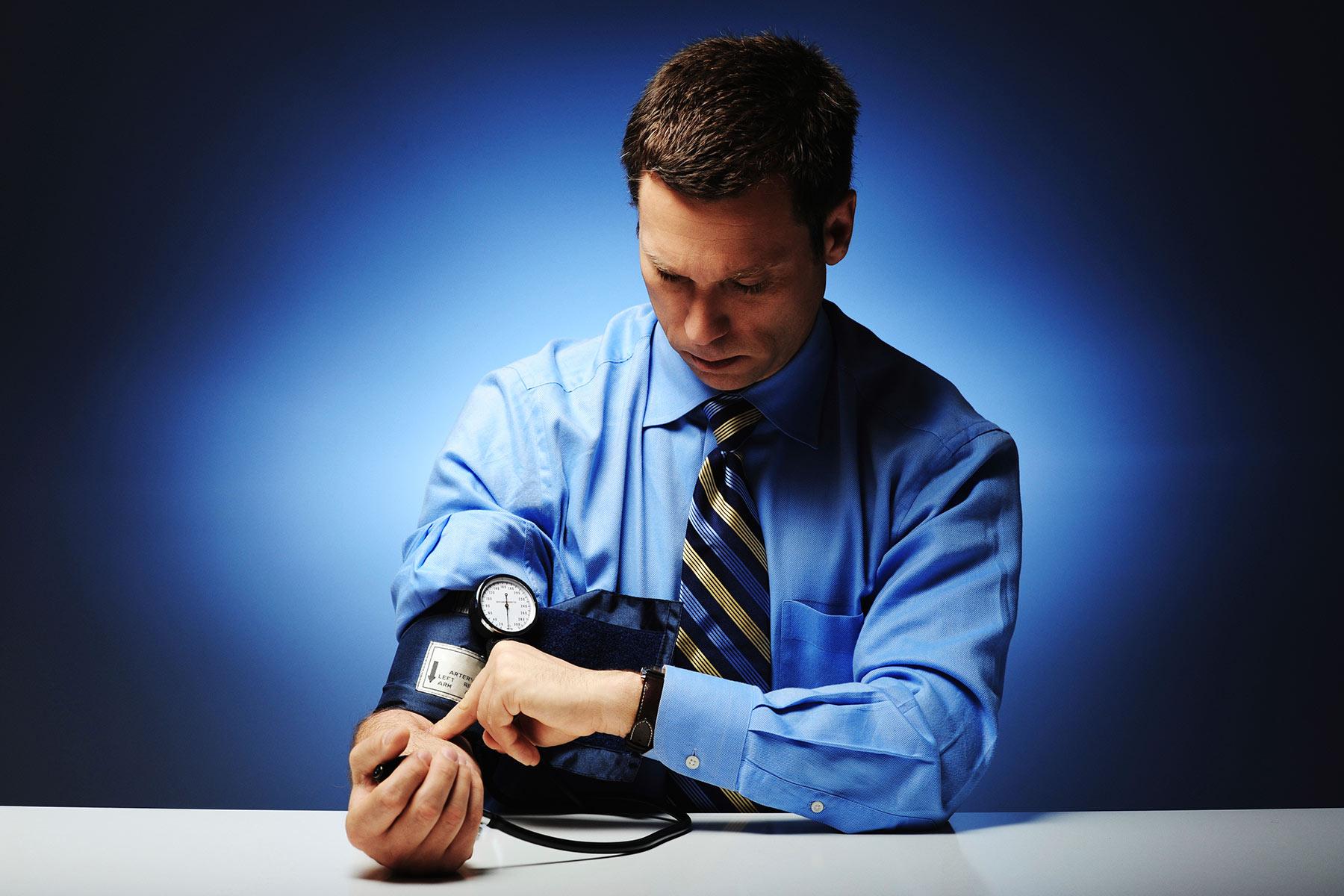 man taking blood pressure reading