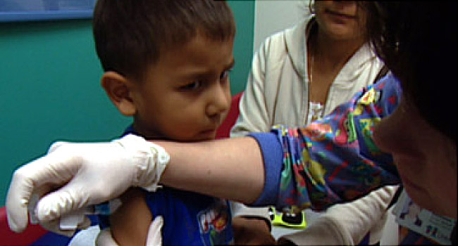 child getting a flu shot