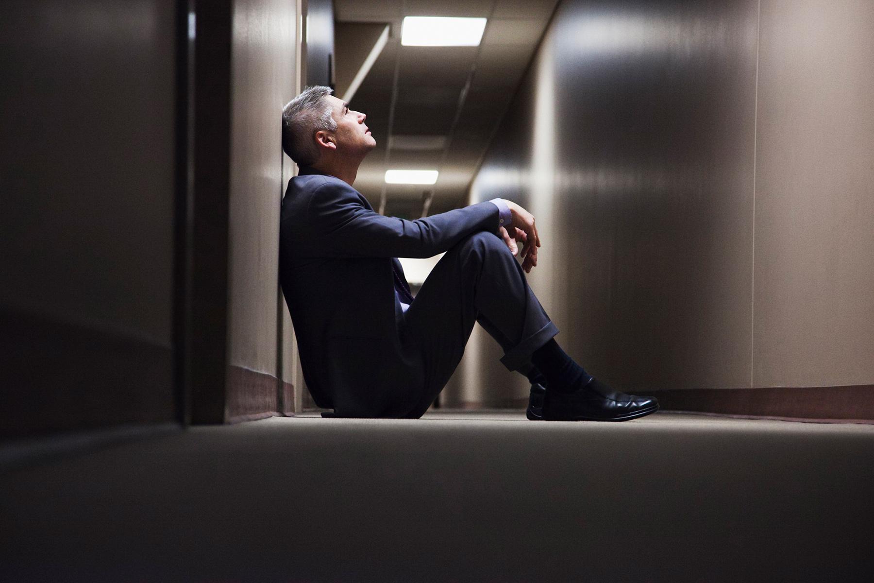depressed man in hallway