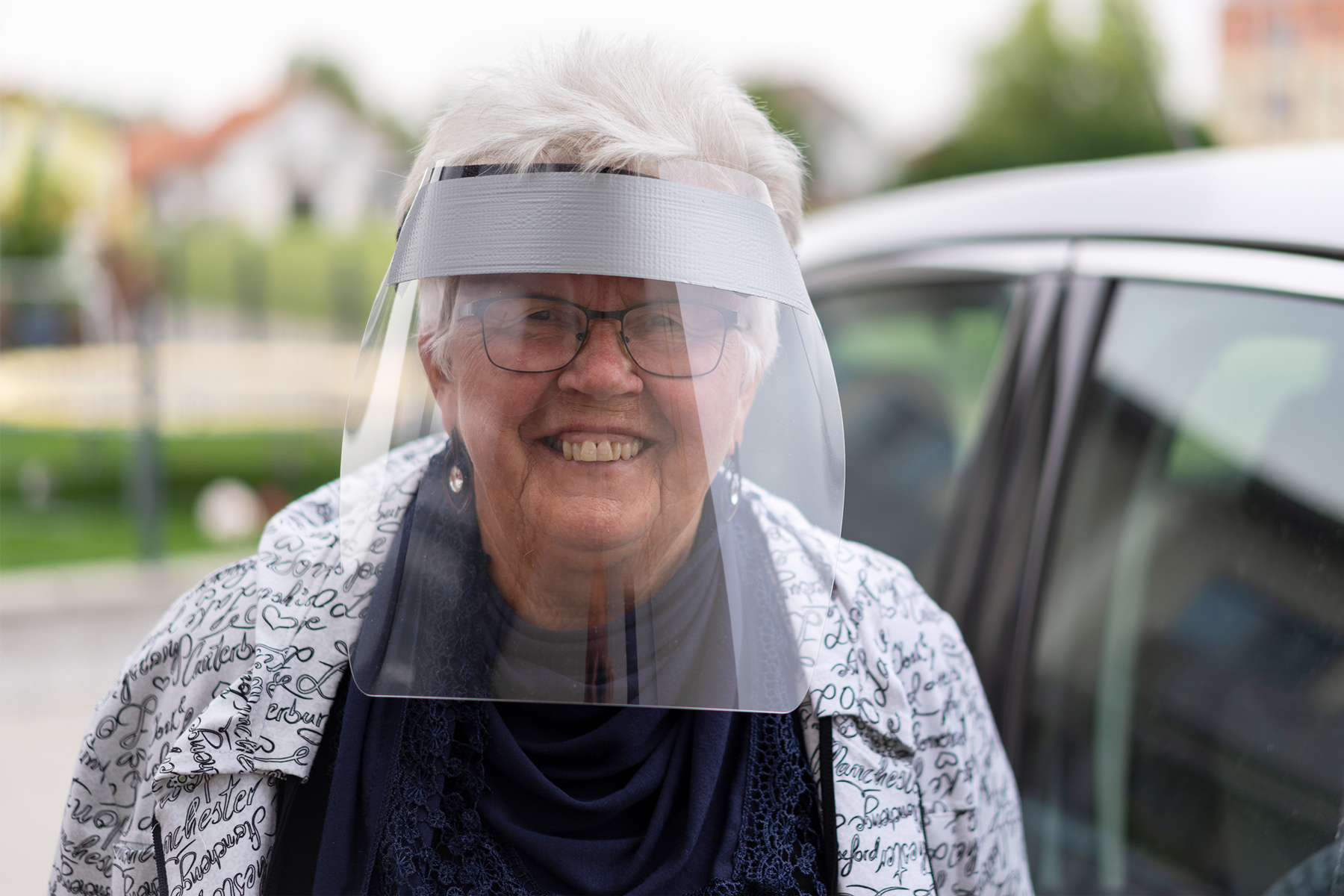 photo of woman wearing face shield