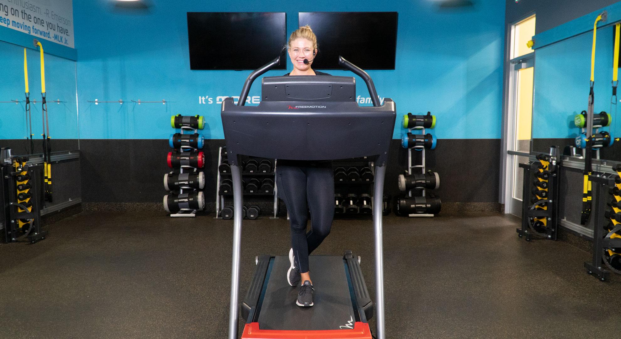 Coach Ashton teaching a treadmill HIIT class on iChuze Fitness