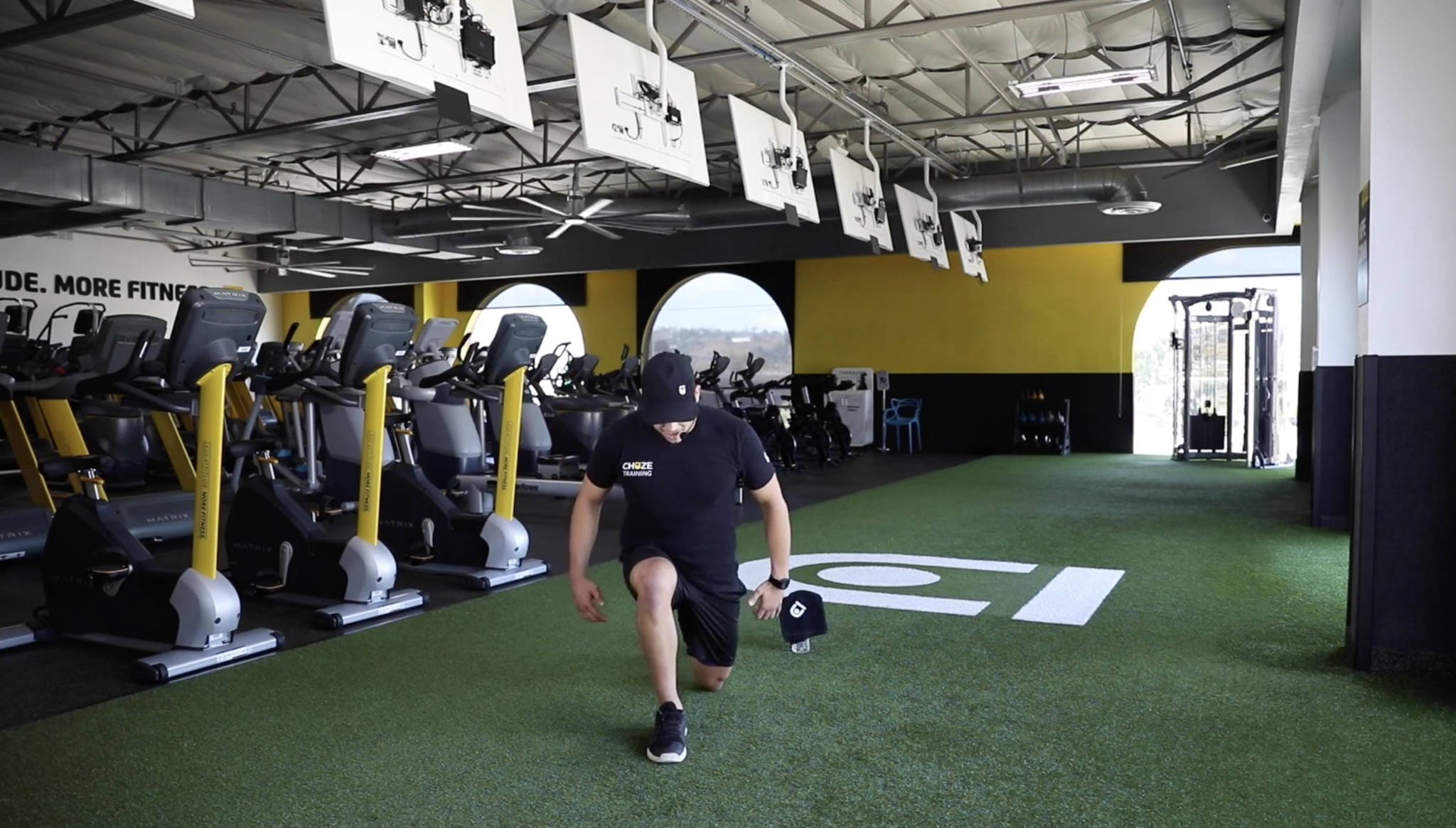 A reverse lunge being displayed by Coach Anthony as in the description above