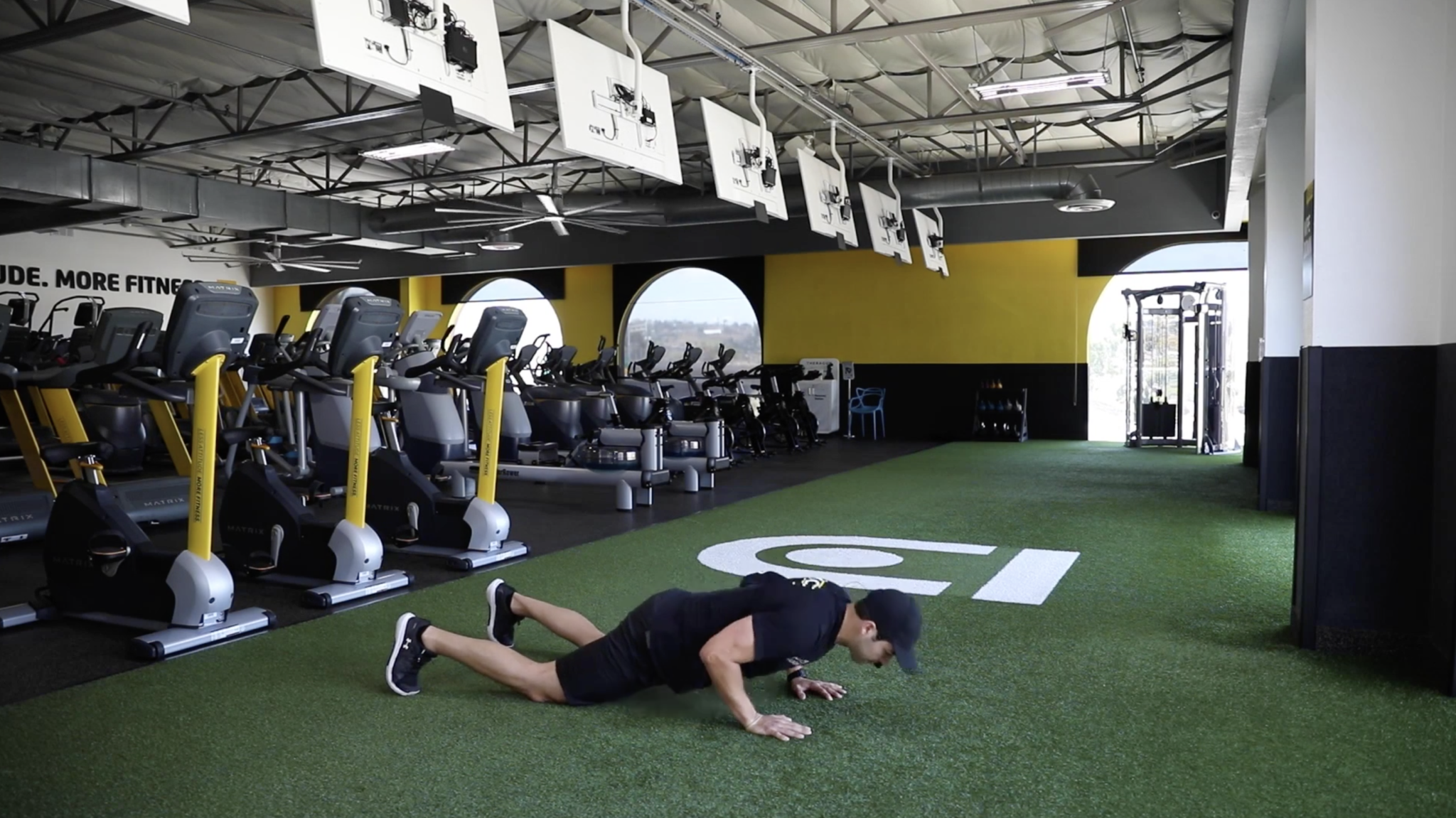 Coach Anthony showing how to do the tricep pushup from your knees after you've started on your toes. Drop your knees to the floor and continue with your hands under your chest.