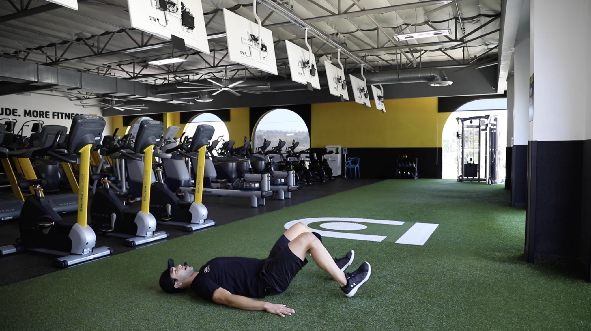 Coach Anthony showing feet placement for an extended hip press. Contrary to the regular hip press, your feet will be further away from your body.