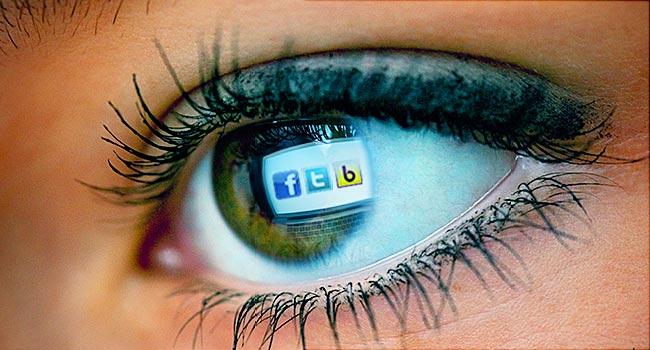 woman staring at social media