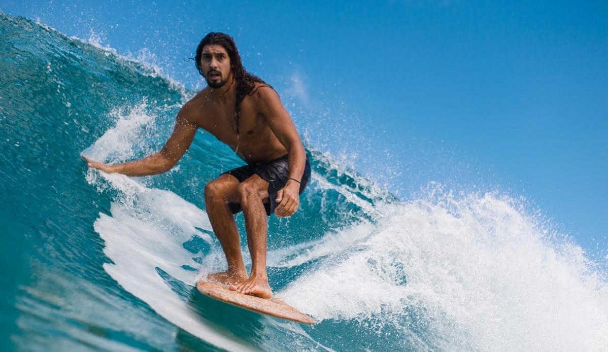 Cliff Kapono rides an alaia.