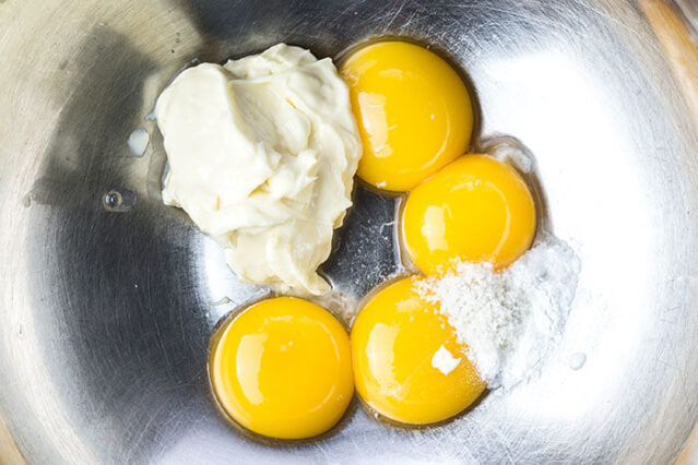 egg yolks and mayonnaise in a bowl for gluten free chocolate cake recipe