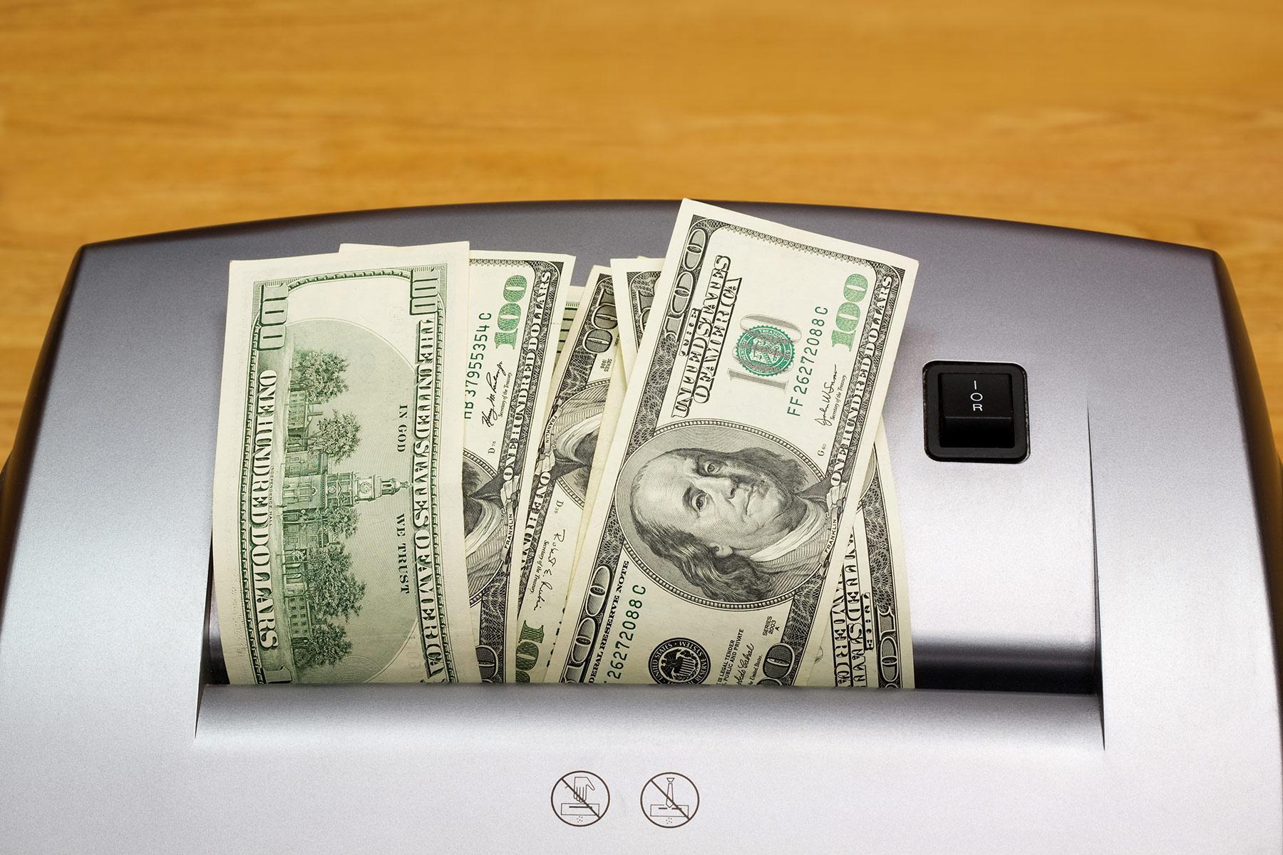 photo of money in shredder