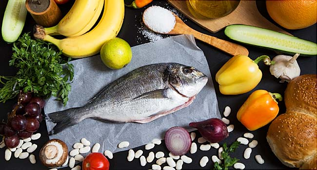 spread of fish vegetable and fruit