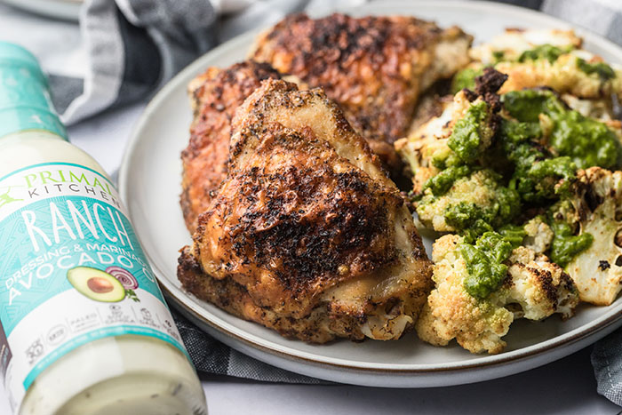 air fryer ranch chicken on a platter with chimichurri cauliflower