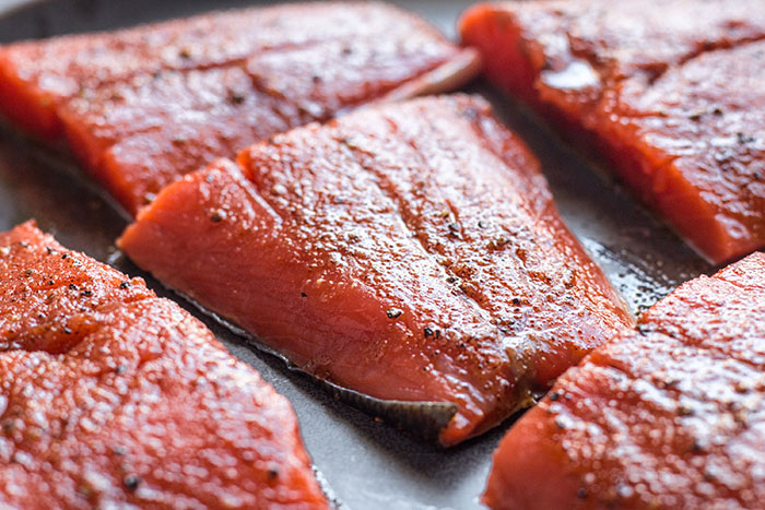 salmon cut into sections for grilled bbq salmon with peach and cucumber salsa recipe